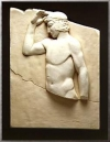 VOTIVE RELIEF OF AN ATHLETE CROWNING HIMSELF