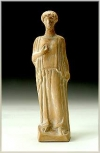 Figurine of a woman wearing a peplos